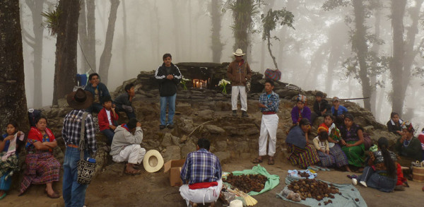"""Ceremony held at the sacred natural site; """"Chu Sqrib'al"""" located on top of the mountain which also hosts the communities """"Rij Juyub' y Buena Vista"""" part of the municipality """"San Andres Sajcabaja"""" in the """"Quiché"""" district.  The sacred natural sites is of great spiritual and historic significance to the Maya as it is also mentioned in the """"Popul Vuh"""", one of the Mayas ancient spiritual scriptures. Source: Bas Verschuuren, 2012."""