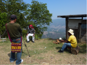 Traditional Maya elder Don Miguel Castro from the community of Buena Vista Sacjabja is being interviewed and filmed by his fellow community members as part of the training on participatory video making.