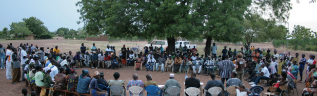 A meeting to discuss research and protocols for safeguarding the sacred groves of Tanchara Community in north west Ghana. The Centre for Indigenous Knowledge and Organisational Development in Ghana has been supporting long term community research which has resulted into a community protocol. The process that required the community to establish agreements and work with several external NGO's - such as the Sacred Natural Sites Initiative - and resulted in a moratorium on gold mining and a conservation plan for their sacred groves. Source: Daniel Banuoku Faalubelange.